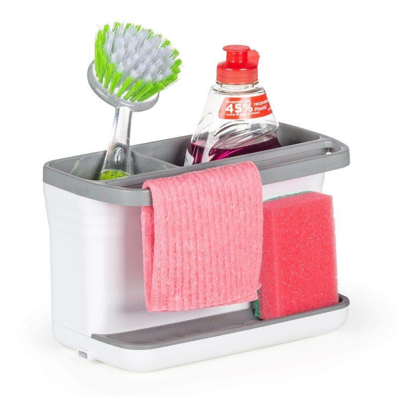 Mali, ali izuzetno zgodan kuhinjski organajzer za odlaganje sredstava za čišćenje. Veća pregrada je savršena za skladištenje deterdženta, a manja za četke za čišćenje. Silikonska stopa za sunđer za čišćenje će zadržavati sav višak voda, tako da više nećete imati problema sa kapanjem. Praktična ručka je idealna za vešanje kuhinjske krpe. Jednostavno podignite gornji deo i prospite višak vode koji se nakupio. Najpogodniji i najjednostavniji način za skladištenje sunđera, deterdženata i drugih sredstava za čišćenje - sve na jednom mestu.